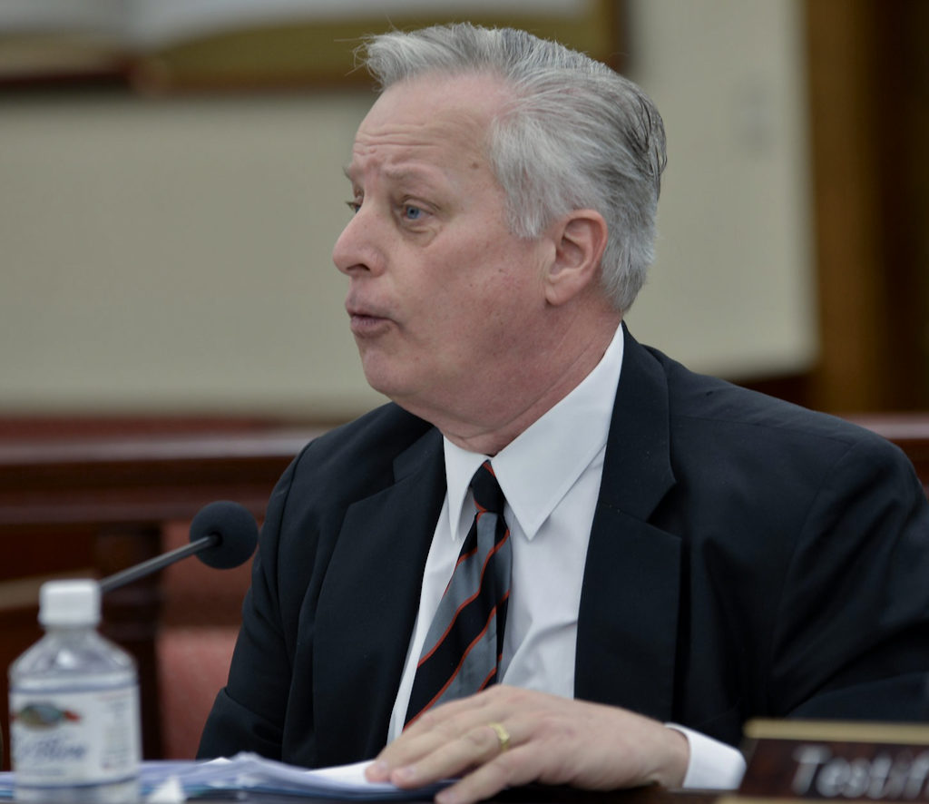 AT&T Legal Counsel Tom Bolt testifies before Wednesday's committee. (Photo by Chaunte Herbert for the V.I. Legislature)