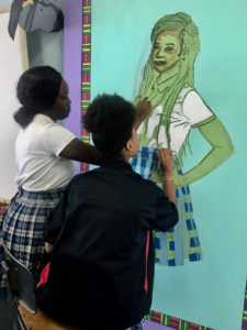 From left, Gelysia Anderson and Era Daniel work on Kehinde Wiley-inspired art. (Photo submitted by Danica David)