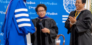 UVI president David Hall congratulates AG Loretta Lynch on reciept of her honorary degree as vice chair Oron Roebuck, right, looks on. (Source photo by Elisa McKay)