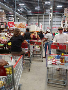 While the government prepares to close farmers markets to prevent the spread of the coronavirus, shoppers find themselves in long, tightly packed lines at Cost U Less on St. Thomas. Source photo by S. Pennington)