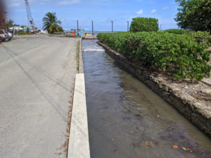 A seawater wave inundates a drainage gut in Christiansted. (Photo submitted by Hilary Lohmann, DPNR, and Greg Guannel, UVI)
