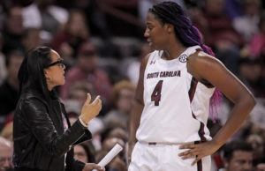 Aliyah Boston listens to AP Coach of the Year Dawn Staley. (Photo by South Carolina Athletic Department)