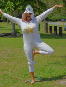 Danielle Marie, dressed as a unicorn, is one of the instructors for Breathe Yoga for Kids. (Source photo by Shaun Pennington)
