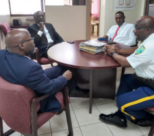 From left, Commissioner Trevor Velinor, St. Thomas District Police Chief Ludrick Thomas, Deputy Commissioner of Police Operations Dr. Celvin Walwyn, and Assistant Commissioner of Police Mario Brooks discussing COVID-19 matters. (VIPD photo)