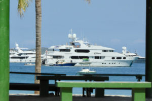 A super yacht as seen through the supports of a Magens Bay shed. ((Source photo by S. Pennington)