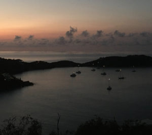 Mast lights shine above boats as the sun rises over the normally empty Rendezvous Bay on St. John's south side. (Photo by Amy Roberts)