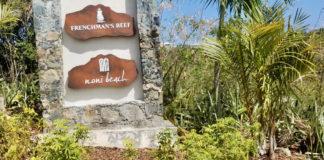 The newly erected sign for Frenchman's Reef and Noni Beach sits below the turnoff to the shuttered resort. (Source photo by Bethaney Lee)