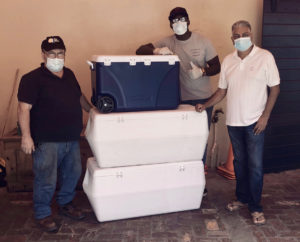 Scott Bradley, Julius Jackson, and Pash Daswani are ready to transport meals purchased by Daswani from MBW for the emergency room staff at the Snider Regional Medical Center. (Photo provided by My Brothers Workshop)