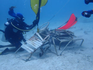Divers attach lift bags to debris, which included lawn chairs and galvanized metal. (Photo submitted by Howard Forbes Jr.)