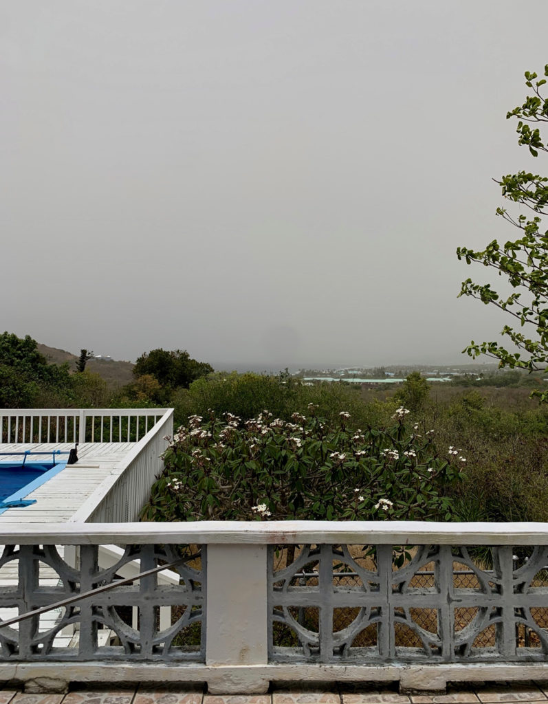 This St. Croix home's usual view of Buck Island is obscured by the Saharan dust. (Source photo by Linda Morland)