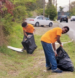 Members of the cleanup place bag roadside trash. (Photo provided by Jody Olsen)