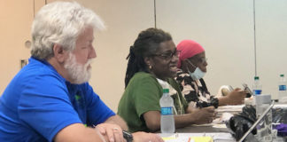 JFL board members, from left, Christopher Finch, Dr. Anne Treasure and Faye John-Baptiste discuss the hospital rebuild.