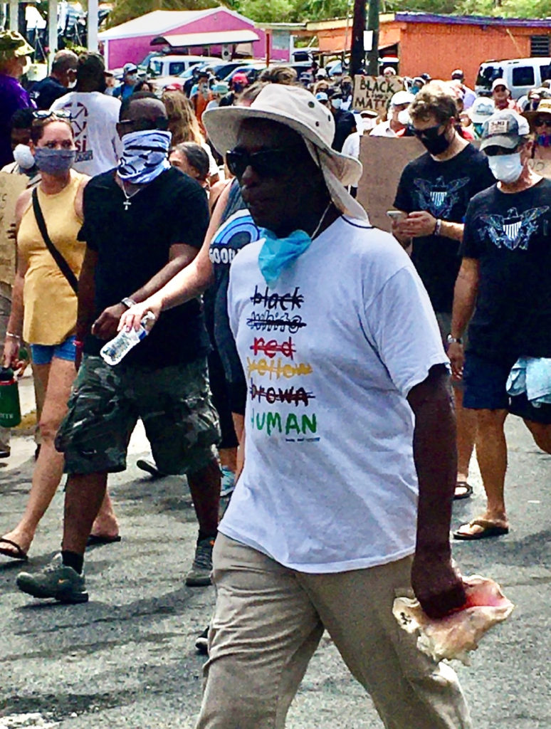 Conch blower Emanuel 'Mano' Boyd where's a 'Human' T-shirt. (Photo by Lisa Etre)