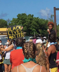 Rally organizer Jalayne Jones addresses the crowd in Cruz Bay Saturday. (Photo by Lisa Etre)