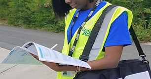 Census workers are wearing royal blue shirts and bright yellow vests, with an ID on a lanyard. (Submitted photo)