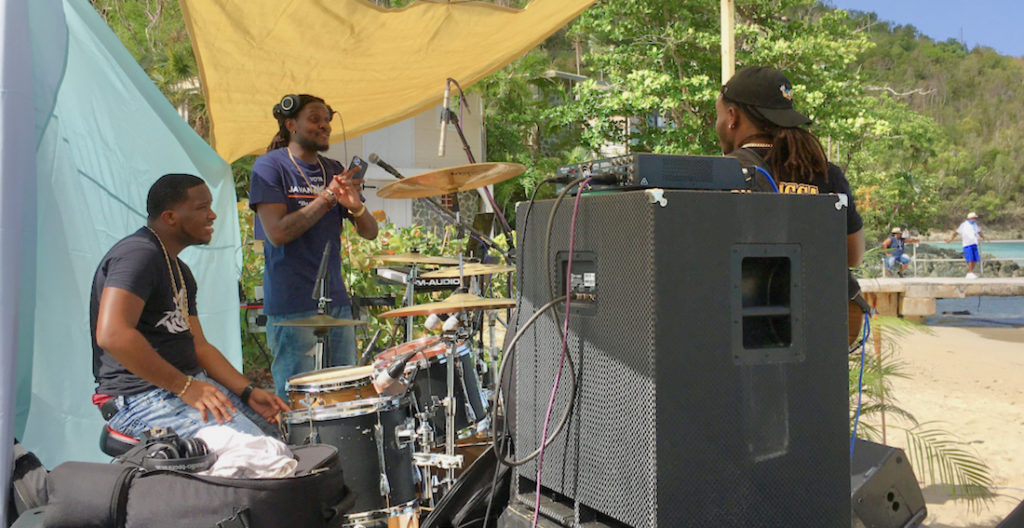 Musicians including Swanks on keyboard, Bugz on vocals, Mic Love on vocals, Rainman on bass and Drive King on drums played from 6 to 11 a.m. to a live audience of fish, seagulls, and visitors on a dozen sailboats. (Source photo by Amy H. Roberts)
