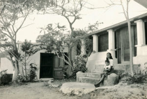 Helen Randall and child on the steps of the house on Lameshur. (Photo from National Park Service archive)